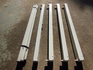 Four 4-ft fluorescent light fixtures with single tubes