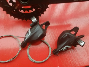 Sram X7, X9 shifters and derailleurs.