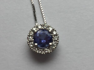 Ladies' 14 KT white gold pendant with tanzanite stone.