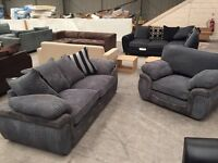 Grey chorded 3 seater sofa with matching large armchair