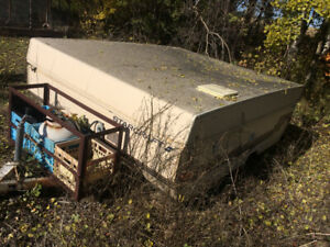 trailer frame.  An old tent trailer, but now just a quad frame