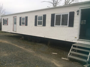 14x64 Prestige Mobile Home (Ready to move with some utilities)