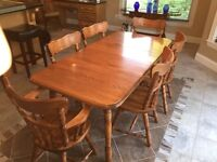 Wood dining room set including table, chairs and hutch