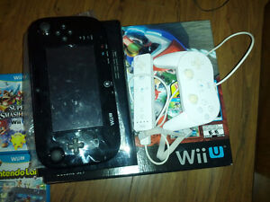 Wii U with 4 games and 2 controllers