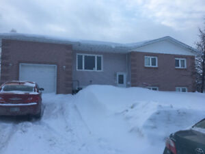 LARGE OPEN CONCEPT BUNGALOW WITH ATTACHED GARAGE!