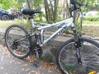 "Mountain bike 24"" with aluminum wheels."