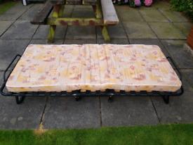 Fold up single bed plus Matress