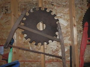 ANTIQUE SAW BLADES AND HAND SAWS