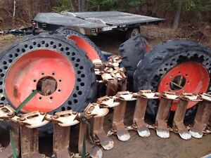 Skid steer solid rubber tires and metal tracks