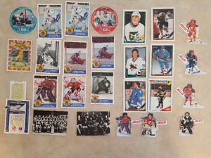 Assortment of  Hockey Cards ( 24 )  and  Baseball  Cards ( 2 ) .