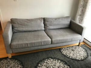 IKEA Karlstad sofa with gray and green covers