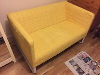 Yellow IKEA two seat sofa for sale