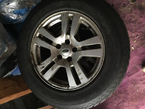Four great condition rims and tires only used for 3 months