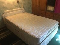 Adjustable bed with massage mattress