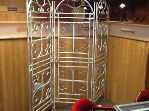 Solid metal room divider