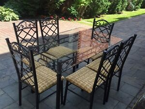 Indoor glass table set with chairs