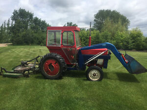 International 284 compact tractor w/loader, mower and cultivator
