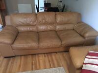 Tan leather sofa and chair