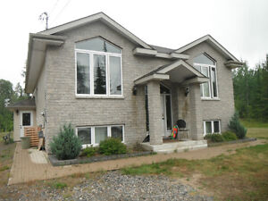 Furnished 4 bedroom newer built home with 6 acres, city limits