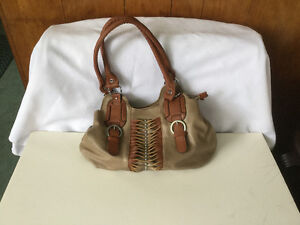 Attractive clean two tone brown handbag