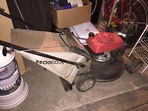 "Honda 21"" rear-bagging and mulching gas lawnmower."