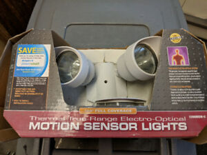Motion sensor light. New in box