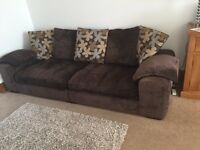 Large comfy brown material sofa
