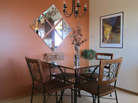 Pier 1 Rattan dining table and four matching chairs