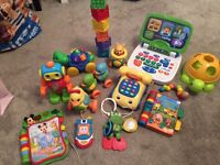 Mixture of baby toys, activity table, Bob the builder