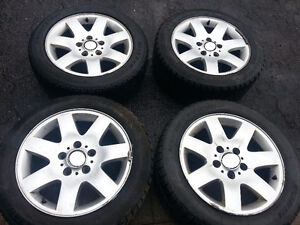 BMW E46 3 Series OEM FOUR Rims and center caps on Tires