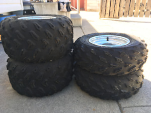 Front and Back Tires & Rims for a 2007 Yamaha Raptor