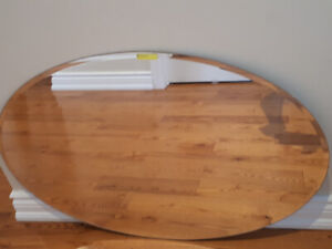 Oval Mirror. 36 inches by 24 inches. To be mounted.