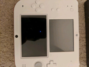 Nintendo 2ds with Mario bros and the Simpsons