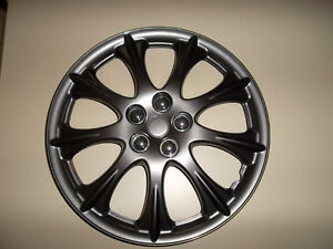 "GM CAP DE ROUE HUBCAP  ENJOLIVEUR 15"" NEUF GM  WHEEL COVER"