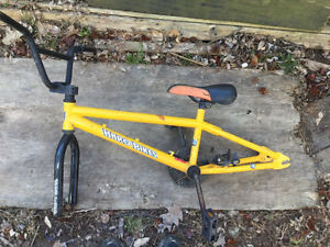 Yellow bike frame and tires with tubes