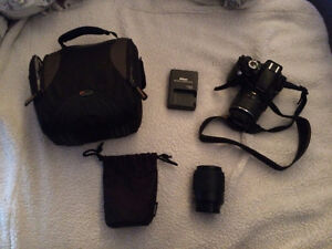 Nikon D3100 with case, charger and DX 55-200mm lens with case