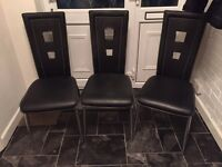 3 black and chrome dining chairs