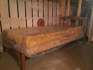 Two solid maple twin bed frames with mattress and box spring