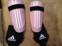 Adidas soccer shoes and shin pads