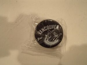 Vancouver Canucks Hockey Puck  Beer Bottle Opener