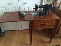 Antique Kenmore Swing Machine with wood cabinet