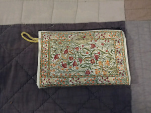 Cute little embroidered bag, good for something small $3