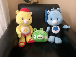 2 care Bears one angry bird pig that snorks