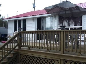 2 bedroom cottage for rent on the Shediac River .