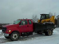 MAN WITH BACKHOE AND FLOAT TRAILER,DUMP TRUCK