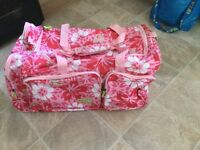 Solar pink and white flower detail large hold-all suitcase with over body strap