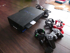 Playstation 2 with 2 controllers, 2 memory cards