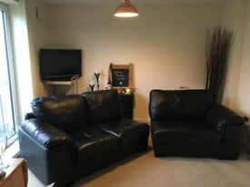 Four seater black quality leather sofa for sale