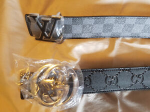 2 black leather belts with silver name brand buckles only $40 ea