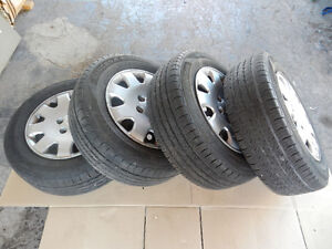 215 65R 16 All Season 4 tires (almost new) with rims $265